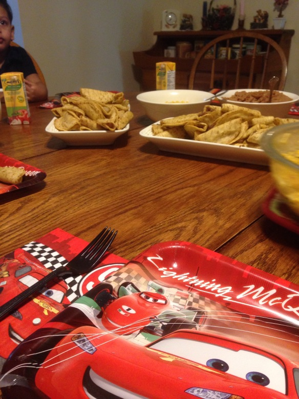 Toddler birthday dinner - mini tacos and juice boxes with car-themed plates!